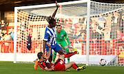 Gaetan Bong blocking Shamir Fenelon's shot during the Pre-Season Friendly match between Crawley Town and Brighton and Hove Albion at the Checkatrade.com Stadium, Crawley, England on 22 July 2015. Photo by Michael Hulf.