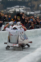 The Latvian team of Janis Minins, Daumants Dreiskens, Oskars Melbardi and Intars Dambis compete in the Mens' four-person bobsleigh World Cup competition held at the Whistler Sliding Centre on Feb 7, 2009