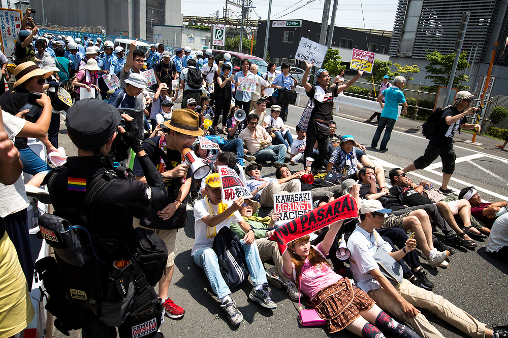 KAWASAKI, JAPAN - JULY 16: Anti-racist groups tried to block Japanese nationalists from marching on the street during a counter-protest rally demanding an end to hate speech in Kawasaki City, Kanagawa prefecture, Japan on July 16, 2017. Scuffles erupted during a counter-protest on racism in Kawasaki City's Nakahara on Sunday, during a right-wing activists attempt to march with their slogans, flags, racist speech, forcing police to intervene. (Photo by Richard Atrero de Guzman/NUR Photo)