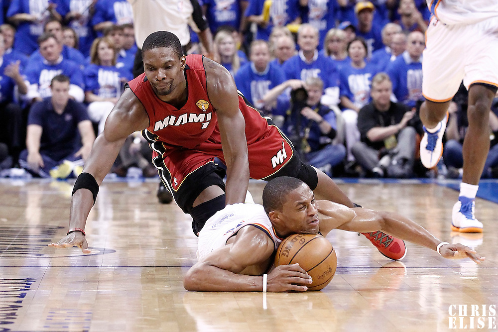12 June 2012: Miami Heat power forward Chris Bosh (1) vies for the loose ball with Oklahoma City Thunder point guard Russell Westbrook (0) during the second half of Game 1 of the 2012 NBA Finals between the Heat and the Thunder, at the Chesapeake Energy Arena, Oklahoma City, Oklahoma, USA.