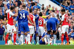 Branislav Ivanovic of Chelsea pushes away Laurent Koscielny of Arsenal as Santi Cazorla is sent of by referee Michael Dean - Mandatory byline: Rogan Thomson/JMP - 07966 386802 - 19/09/2015 - FOOTBALL - Stamford Bridge Stadium - London, England - Chelsea v Arsenal - Barclays Premier League.