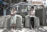 Two young women with their children born within the cervix cemetery. Both are married to two brothers, also very youth, who were born andalways lived in the cemetery.