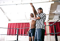 Referee announces winner of wrestling match