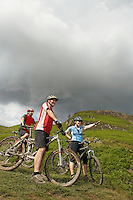 Three cyclists on hillside
