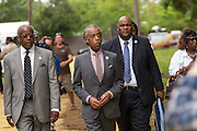 Rev. Al Sharpton arrives for a peace vigil at the spot where unarmed motorist Walter Scott was gunned down by police April 12, 2015 in North Charleston, South Carolina. About 100 people showed up for the brief vigil following a healing service at Charity Mission Baptist Church.