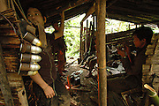 Soldiers rest in their abandoned village, near Vang Vieng, Laos, July 2, 2006...**EXCLUSIVE, no tabloids without permission**  .Pictured are a group of Hmong people who report an attack against them April 6, 2006 by Lao and Vietnamese military forces.  26 people perished, 5 were injured, and 5 babies died shortly after because their dead mothers could not breast-feed them.  Only one adult male was killed, the other 25 victims were women and children (17 children).  The Lao Spokesman for the Ministry of Foreign Affairs says this is a fabrication, an investigation has been completed, and there was no attack.  The Hmong group says no officials have interviewed witnesses or visited the crime scene, a point the Lao Spokesman did not deny.  ..The Hmong people pictured have hidden in remote mountains of Laos for more than 30 years, afraid to come out.  At least 12,000 are said to exist, with little food, scavenging in the jungle. Most have not seen the modern world.  The CIA trained and funded many Hmong hill tribes in Laos from 1961 to 1973 to fight communism.  The Hmong suffered massive casualties defending their homeland and rescuing US pilots.  When America withdrew from the conflict most Hmong were left alone to face the might of the North Vietnamese Army.  The Royal Lao Government fell to the communists and the Hmong became outcasts in the country they fought to defend.  Since 1975, under the communists, thousands of reports evidence the Hmong have suffered frequent persecution, torture, mass executions, imprisonment, and possible chemical weapons attacks.  Reports of these atrocities continue to this day.  The Lao Government generally denies the jungle people exist or that any of this is happening.  The Hmong group leader, Blia Shoua Her, says they are not part of the Hmong resistance and want peace.  He claims they are just civilians defending their families, hoping to surrender to the UN....