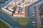 Nederland, Utrecht, Leidsche Rijn, 25-11-2008; drijvende huizen in de wijk Terwijde, omgeven door reguliere koophuizen, eengezinswoningenfloating houses in the neighborhood Terwijde, surrounded by mainstream houses .  .luchtfoto (toeslag)aerial photo (additional fee required).foto Siebe Swart / photo Siebe Swart