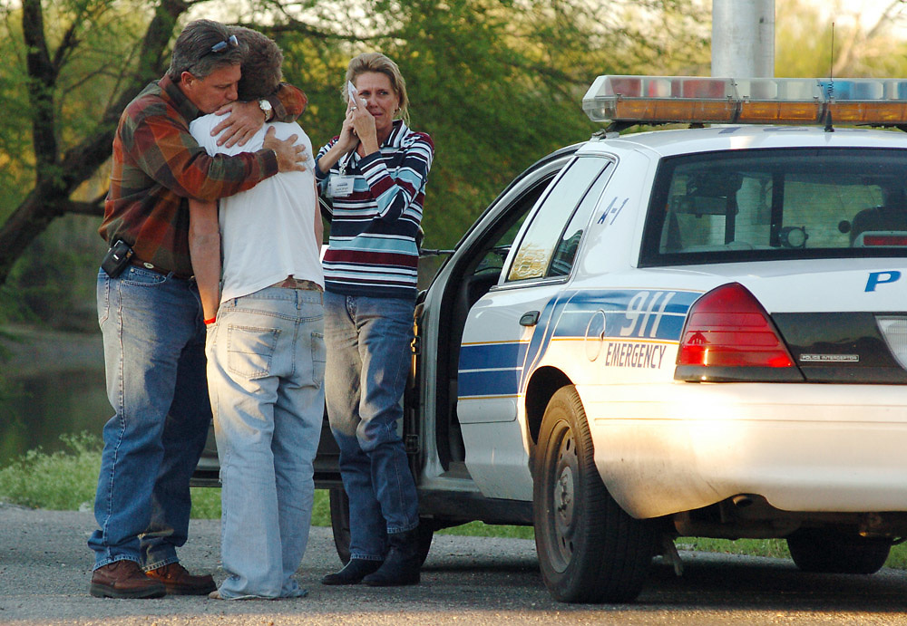 Michael Zamora/Caller-Times.Family members who did not want to be identified cry and embrace after speaking with the medical examiner Tuesday, Oct. 23, 2007, near the scene of a fatal train accident near the boat docks by Nueces River Park in the Calallen area of Corpus Christi. One girl was killed as a group of teenagers crossed the train bridge over the Nueces River about half a mile east of the I-37 bridge.
