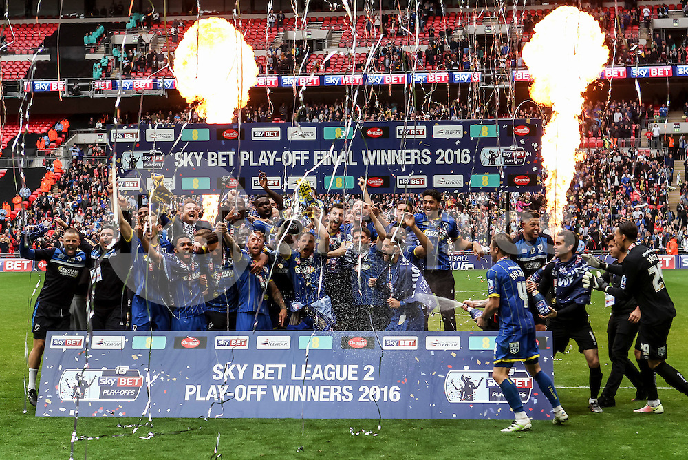 AFC Wimbledon win promotion to Skybet League 1<br /> during the Sky Bet League 2 Play-Off Final between AFC Wimbledon and Plymouth Argyle at Wembley Stadium, London, England on 30 May 2016. Photo by Ken Sparks.