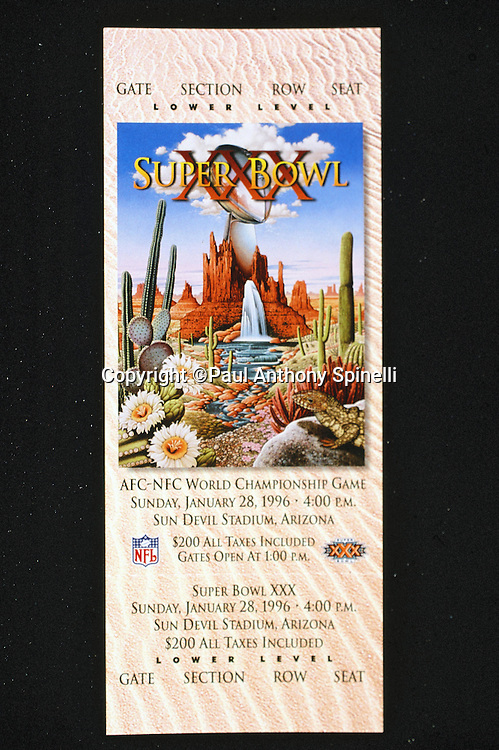 A Super Bowl XXX ticket features desert cactus, red mountains, and related environs as part of the artwork for the Super Bowl matchup between the Dallas Cowboys and the Pittsburgh Steelers in the NFL championship football game on Jan. 28, 1996 in Glendale, Az. The Cowboys won the game 27-17. (©Paul Anthony Spinelli)