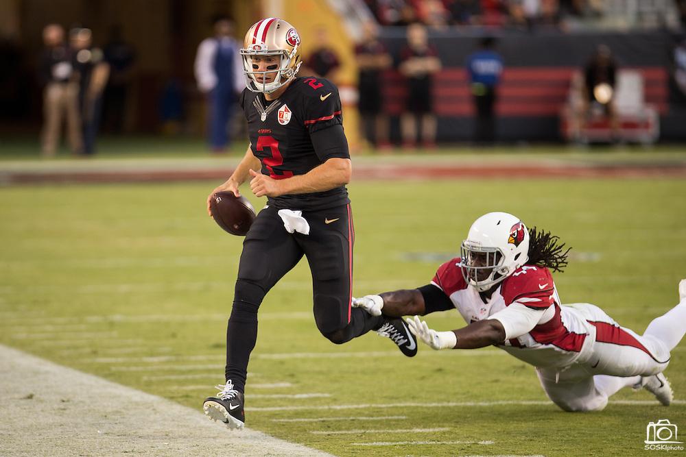 San Francisco 49ers quarterback Blaine Gabbert (2) runs out of bounds to avoid a Arizona Cardinals tackle at Levi's Stadium in Santa Clara, Calif., on October 6, 2016. (Stan Olszewski/Special to S.F. Examiner)