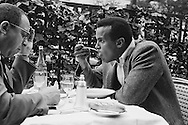 Lunch interview of Harry Belafonte with Art Buchwald of the New York Herald Tribune in Le Fouquet's an upscale french caf&eacute; on Avenue George V in Paris.<br />
