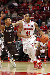 27 November 2015: DeVaughn Akoon-Purcell(44) takes it to the hoop guarded by Herm Senor II. Illinois State Redbirds host the Quincy Hawks at Redbird Arena in Normal Illinois (Photo by Alan Look)