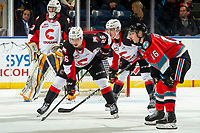 KELOWNA, BC - NOVEMBER 1:  Michael Farren #16 of the Kelowna Rockets lines up with Reid Perepeluk #26 of the Prince George Cougars at Prospera Place on November 1, 2019 in Kelowna, Canada. (Photo by Marissa Baecker/Shoot the Breeze)