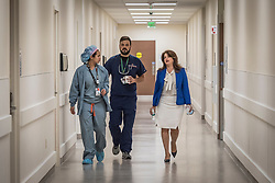 Silvia Prieto, MBA, MHS, Vice Chair of the Department of Radiology at the University of Miami, speaks with medical staff at the Lennar Foundation Medical Center at the University of Miami.
