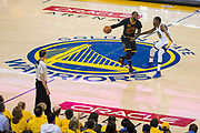 Cleveland Cavaliers forward LeBron James (23) handles the ball at mid-court against Golden State Warriors forward Kevin Durant (35) during Game 5 of the NBA Finals at Oracle Arena in Oakland, Calif., on June 12, 2017. (Stan Olszewski/Special to S.F. Examiner)
