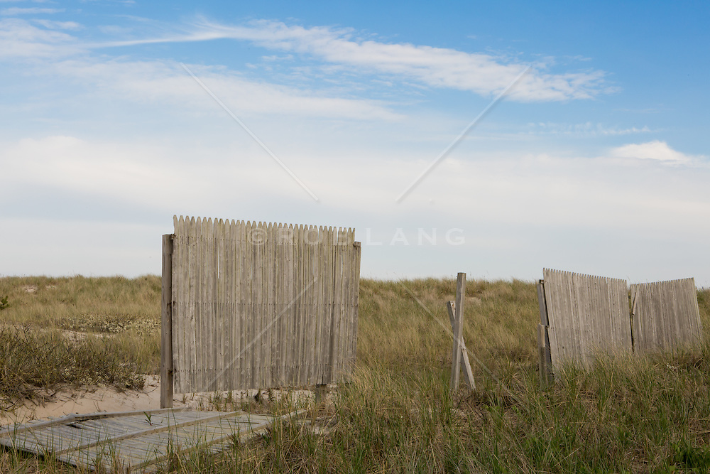 broken wooden fence on the beach in Southampton,NY