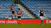 Football - 2019 / 2020 Emirates FA Cup - Fourth Round: Millwall vs. Sheffield United<br /> <br /> Ollie Norwood (Sheffield United) celebrates in front of the travelling fans located in the upper tier at The Den.<br /> <br /> COLORSPORT/DANIEL BEARHAM