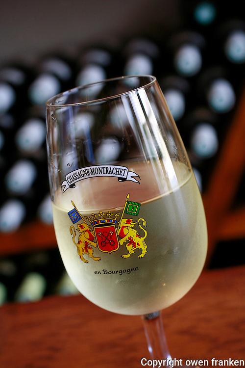 Glass of white wine at the tasting center in Burgundy's Chassagne- Montrachet