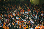 30th August 2019; Dens Park, Dundee, Scotland; Scottish Championship, Dundee Football Club versus Dundee United; Dundee United fans celebrate as their team go 4-1 ahead