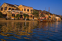 Hoi An's picturesque waterfront in late afternoon light isseeming mirrored in the Thu Bon river.