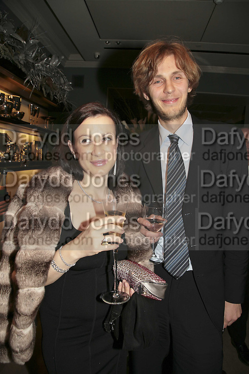 Annabel and Michail Mamon, THE CHRISTMAS PARTY CELEBRATING THE 225TH ANNIVERSARY OF ASPREY. 167 NEW BOND ST. LONDON W1. 7 DECEMBER 2006. ONE TIME USE ONLY - DO NOT ARCHIVE  © Copyright Photograph by Dafydd Jones 248 CLAPHAM PARK RD. LONDON SW90PZ.  Tel 020 7733 0108 www.dafjones.com
