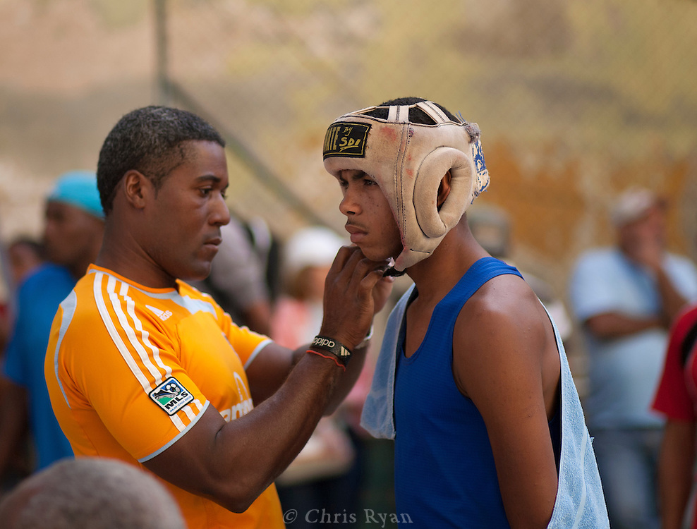 Young boxer suiting up for a fight, Havana, Cuba