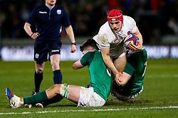 Theo Dan of England U20 is tackled by Alex Soroka and Sean O'Brien of Ireland U20 - Rogan/JMP - 21/02/2020 - Franklin's Gardens - Northampton, England - England U20 v Ireland U20 - Under 20 Six Nations.