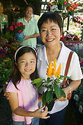 Grandmother and Granddaughter Shopping for Plants