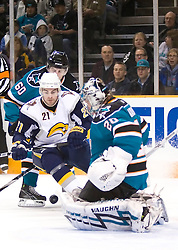 January 23, 2010; San Jose, CA, USA; San Jose Sharks goalie Evgeni Nabokov (20) makes a save in front of Buffalo Sabres right wing Drew Stafford (21) during the first period at HP Pavilion. San Jose defeated Buffalo 5-2. Mandatory Credit: Jason O. Watson / US PRESSWIRE