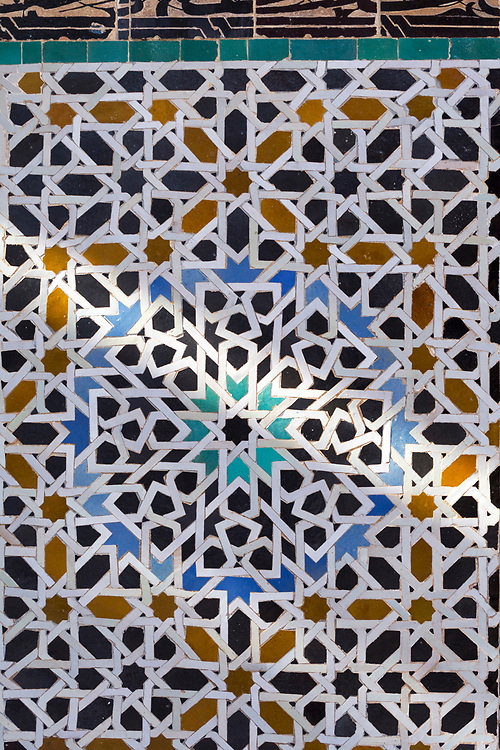 FEZ, MOROCCO - 1st DECEMBER 2016 - Intricate zellige mosaic tiling work at the Bou Inania Madrasa, Koranic School, Fez Medina, Middle Atlas Mountains, Morocco.