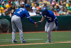 OAKLAND, CA - JULY 23:  Josh Donaldson #20 of the Toronto Blue Jays is congratulated by third base coach Luis Rivera #2 after hitting a home run against the Oakland Athletics during the fifth inning at O.co Coliseum on July 23, 2015 in Oakland, California. The Toronto Blue Jays defeated the Oakland Athletics 5-2. (Photo by Jason O. Watson/Getty Images) *** Local Caption *** Josh Donaldson; Luis Rivera