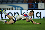 Tom Johnstone of Wakefield Trinity dives over to score the try against Huddersfield Giants during the Betfred Super League Super 8's match at the John Smiths Stadium, Huddersfield<br /> Picture by Stephen Gaunt/Focus Images Ltd +447904 833202<br /> 31/08/2018