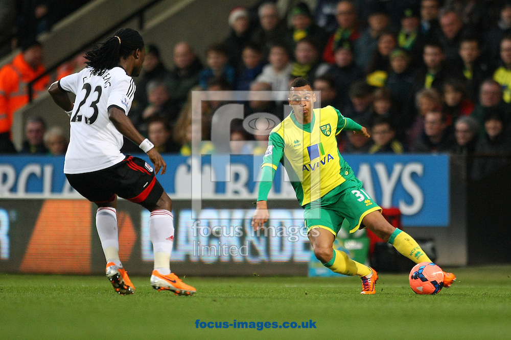 Picture by Paul Chesterton/Focus Images Ltd +44 7904 640267<br /> 04/01/2014<br /> Josh Murphy of Norwich and Derek Boateng of Fulham in action during The FA Cup match at Carrow Road, Norwich.