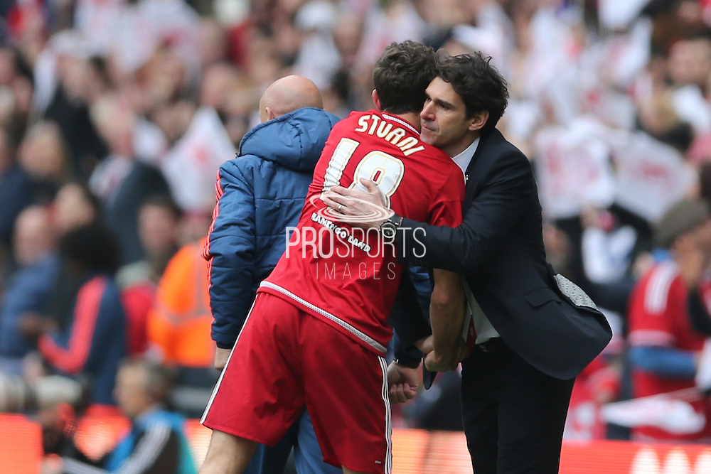 Middlesbrough FC striker Christian Stuani scores to make it 1-0 and celebrates  with Middlesbrough FC Head Coach Aitor Karanka during the Sky Bet Championship match between Middlesbrough and Brighton and Hove Albion at the Riverside Stadium, Middlesbrough, England on 7 May 2016.