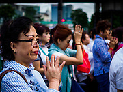 09 NOVEMBER 2017 - BANGKOK, THAILAND: People pray on the sidewalk in front of the Erawan Shrine on the 61st anniversary of the shrine's dedication. The Erawan Shrine is one of the most popular shrines in Bangkok. It was dedicated on November 9, 1956, after a series of construction accidents at what was then the Erawan Hotel (since torn down and replaced by the Grand Hyatt Erawan Hotel). The statue in the shrine is Phra Phrom, the Thai representation of the Hindu god of creation Brahma. It is a Hindu shrine popular with Thai and Chinese Buddhists because it is thought that making an offering to the Phra Phrom will bring good fortune.    PHOTO BY JACK KURTZ