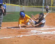 Oxford High's Nikki Grillette (14) scores as Olive Branch catcher Brooke Gaston (5) drops the ball in girls high school softball in Oxford, Miss. on Saturday, February 26, 2011.
