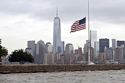 Sept. 11, 2014 - New York, NY, United States of America - The American flag on Ellis Island at half-staff on a cloudy day with the Freedom Tower and skyline of Manhattan during the 13th anniversary of the 9/11 terrorist attacks September 11, 2014. (Credit Image: © Po3 Frank J. Iannazzo-Simmons/Planet Pix via ZUMA Wire)
