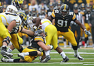 November 05, 2011: Michigan Wolverines running back Fitzgerald Toussaint (28) is hit by Iowa Hawkeyes linebacker Tyler Nielsen (45) as Iowa Hawkeyes defensive lineman Broderick Binns (91) closes in during the second half of the NCAA football game between the Michigan Wolverines and the Iowa Hawkeyes at Kinnick Stadium in Iowa City, Iowa on Saturday, November 5, 2011. Iowa defeated Michigan 24-16.