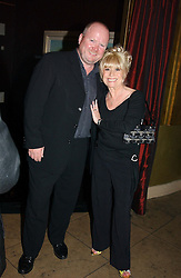 Actor STEVE McFADDEN and actress BARBARA WINDSOR at a party to celebrate the publication of Dot.Homme by Jane Moore held at Embassy Club, Old Compton Street, London on 14th July 2004.