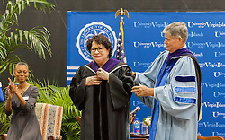 Justice Sotomayor is donned by Henry Smock with the hood signifying her honorary degree.  2017 Student Convocation with featured honored guest the Honorable Sonia Sotomayor, Associate Justice, United States Supreme Court.  UVI Sports and Fitness Center.  St. Thomas, USVI.  9 February 2017.  © Aisha-Zakiya Boyd