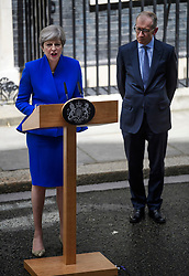 © Licensed to London News Pictures. 09/06/2017. London, UK. British prime minister  THERESA MAY stands next to her husband PHILIP MAY while speaking outside 10 Downing Street in London, following a meeting with Queen Elizabeth II, in which she asked to form a new government. The Conservative Party made substantial losses in an election that they were expected to win comfortably. Photo credit: Ben Cawthra/LNP