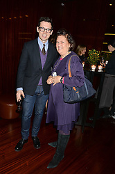 ERDEM MORALIOGLU and SUZY MENKES at a dinner hosted by Liberatum to honour Francis Ford Coppola held at the Bulgari Hotel & Residences, 171 Knightsbridge, London on 17th November 2014.