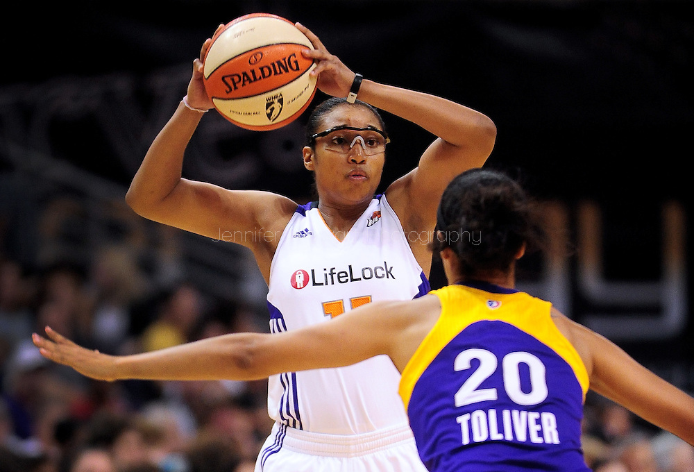Sep 3, 2011; Phoenix, AZ, USA; Phoenix Mercury Ketia Swanier (11) handles the ball against the Los Angeles Sparks guard Kristi Toliver (20) at the US Airways Center.  The Mercury defeated the Sparks 93-77.  Mandatory Credit: Jennifer Stewart-US PRESSWIRE.