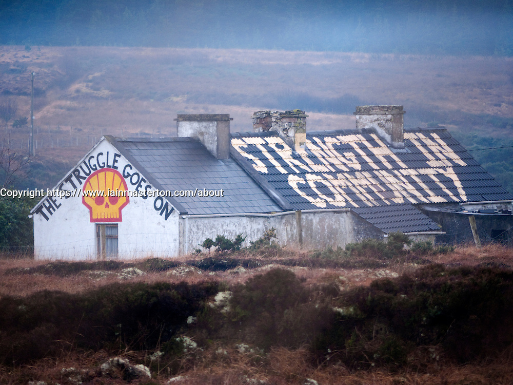 Cottage covered in protest slogans by campaign groups who oppose the Corrib Natural Gas project by Royal Dutch Shell in County Mayo Ireland