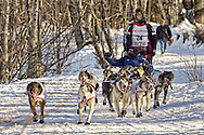 March 7th, 2009:  Anchorage, Alaska - Aliy Zirkle of Two Rivers heads through the Behm Lake woods during the 2009 Ceremonial Start of the Iditarod.