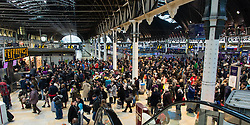 © Licensed to London News Pictures. 27/12/2013. London, UK. Crowds of passengers wait for their trains at Paddington Rail station.  Rail services having been disrupted as a result of adverse weather conditions over the Christmas period. Photo credit : Richard Isaac/LNP