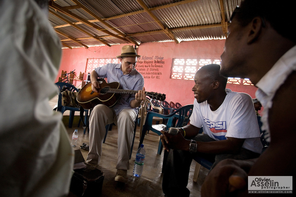 Canadian artist Dave Bidini (right) jams with members of the band King's Jubilee, (seen here are Zaroe Amilcar and Richard Neufville (right)) at the  Buduburam refugee settlement, roughly 20 km west of Ghana's capital Accra on Friday April 13, 2007. The group, which is composed of five Liberian men living at Buduburam, is currently recording their second album, and already has a growing number of fans back in Liberia. The Buduburam refugee settlement is still home over 30,000 Liberians, most of which have mixed feelings about returning to Liberia..
