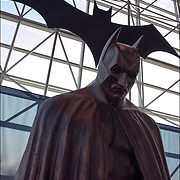 Batman Statue or sculpture of Batman Movie Costume in the Javis Center, NYC.<br /> <br /> The New York Comic Con convention, is a celebration of comic books, graphic novels, sci-fi and video games, toys, movies and television.<br /> <br /> More than 130,000 people attended the event dressed up as their favorite superhero to celebrate comic books, sci-fi and video games.<br /> <br /> The convention brings together celebrities as well as fans of fantasy role playing, Comic-Con is the business of pop culture.