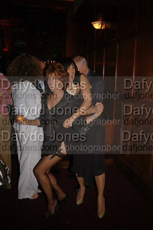 Kathy Lette and Polly Sampson, Krug host the launch of Kathy Lette's book. ' How to Kill Your Husband' the Courthouse Hotel Great Marlborough St. London. 26 April 2006. ONE TIME USE ONLY - DO NOT ARCHIVE  © Copyright Photograph by Dafydd Jones 66 Stockwell Park Rd. London SW9 0DA Tel 020 7733 0108 www.dafjones.com